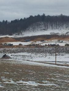 The frac-sand mining process. The hills seen in the background will eventually be cleared and look identical to the foreground